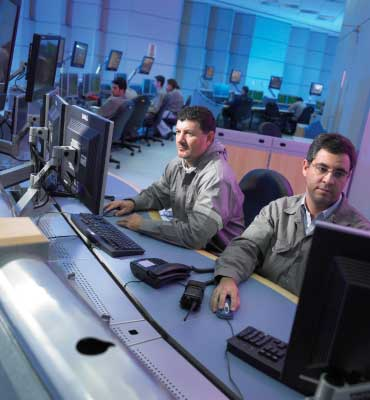 Workers in a control center