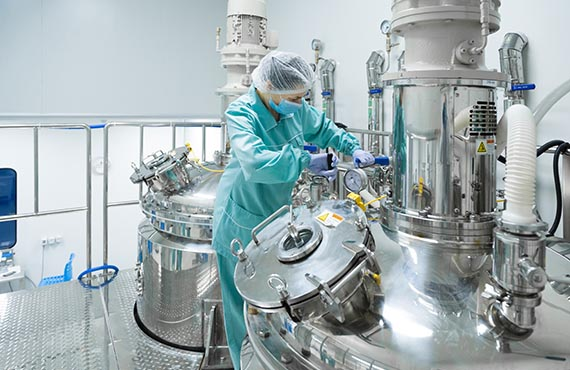 Woman in pharmaceutical manufacturing facility